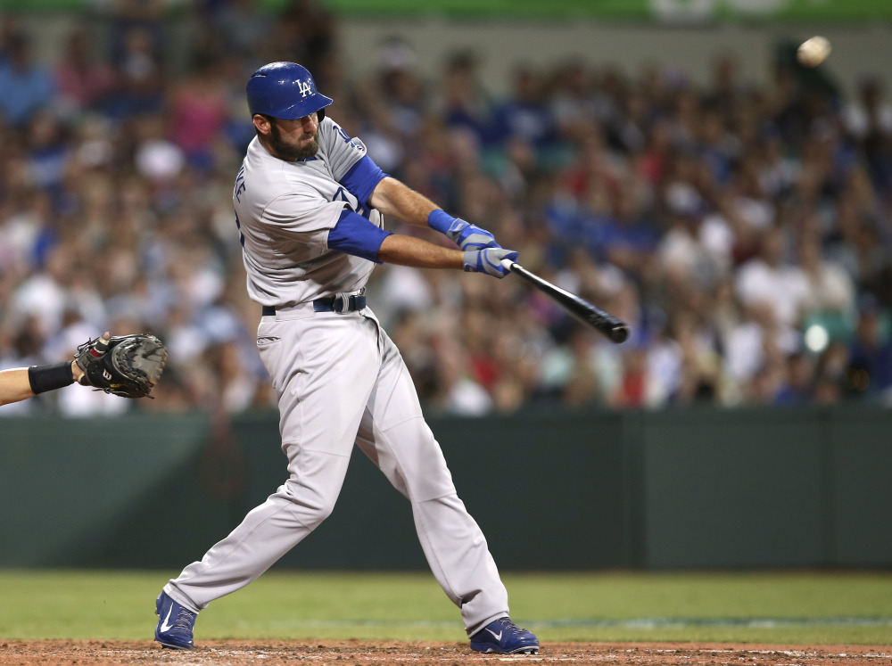 The Los Angeles Dodgers' Scott Van Slyke hits a two-run home run in the season opener between the Los Angeles Dodgers and Arizona Diamondbacks at the Sydney Cricket ground in Sydney, on Saturday.