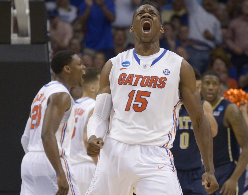 Florida forward Will Yeguete yells after scoring against Pittsburgh, during the second half of Saturday's third-round game in the NCAA tournament Saturday Orlando, Fla. The top-seeded Gators won, 61-45.