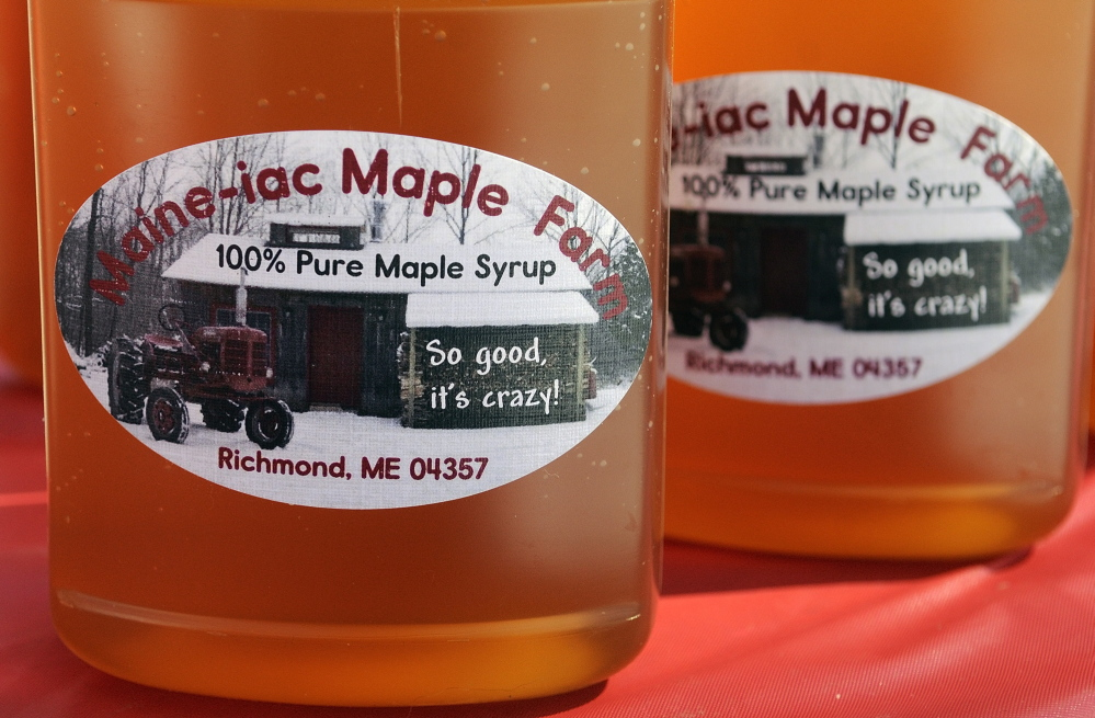 Topping Good: Because the cold weather this year has kept the sap from flowing, only a few pints of syrup have been produced at Maine-iac Maple Farms in Richmond. It was used to top ice cream for visitors on Maine Maple Sunday on Sunday in Richmond.
