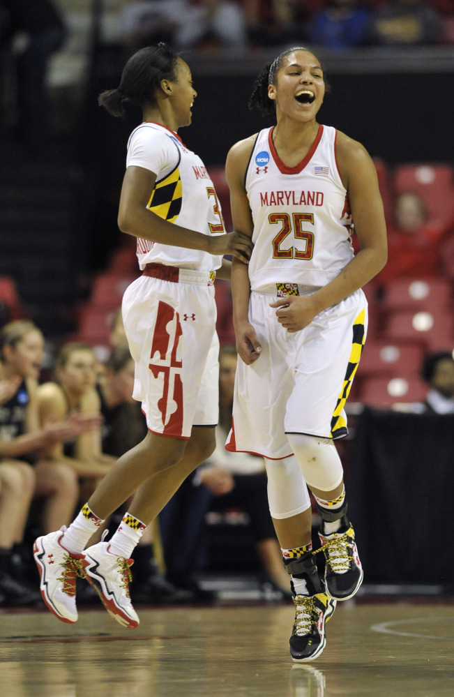 Maryland's Alyssa Thomas, right, and Shatori Walker-Kimbrough celebrate after scoring against Army on Sunday.