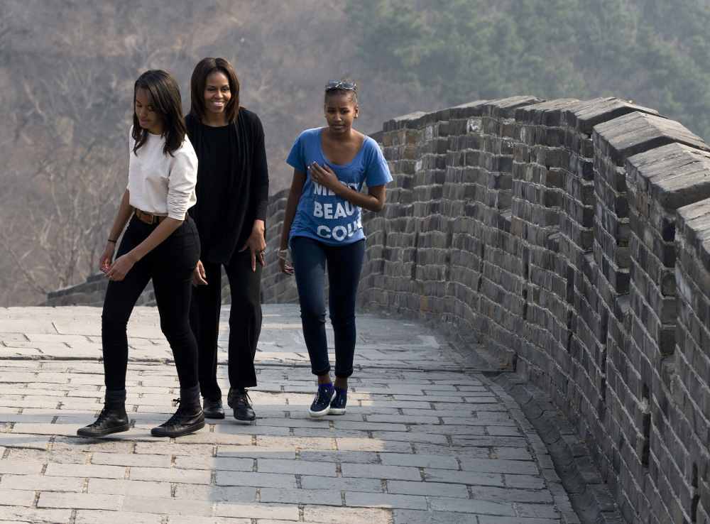 U.S. first lady Michelle Obama walks with her daughters Malia, left, and Sasha, right, as they visit the Mutianyu section of the Great Wall of China in Beijing on Sunday.
