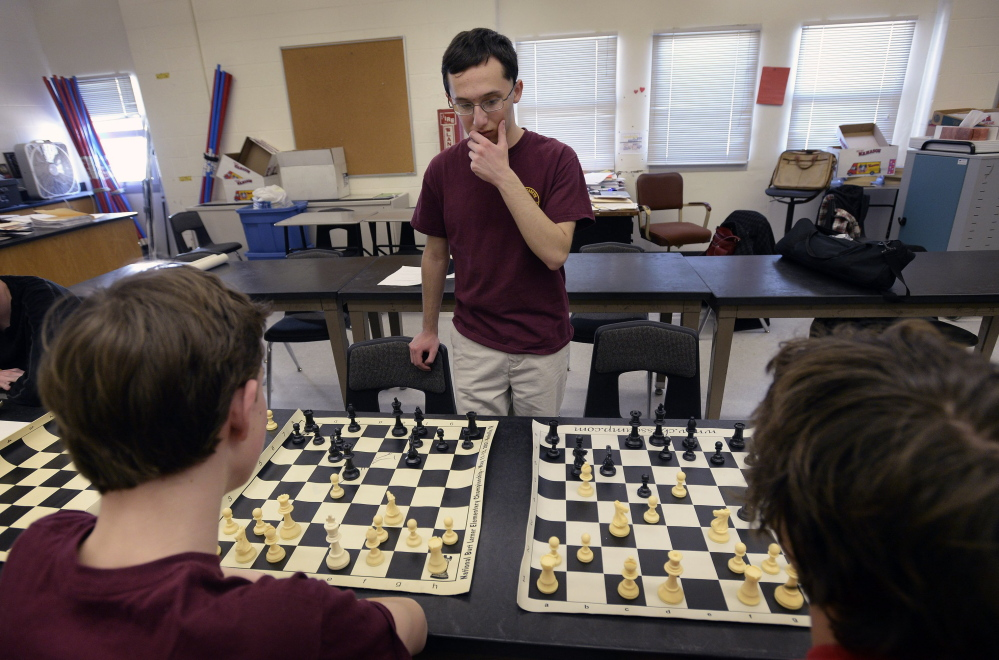 Matthew Fishbein, a sophomore at Cape Elizabeth, contemplates his next move while playing a chess match against two of his teammates at the same time on March 17, 2014.