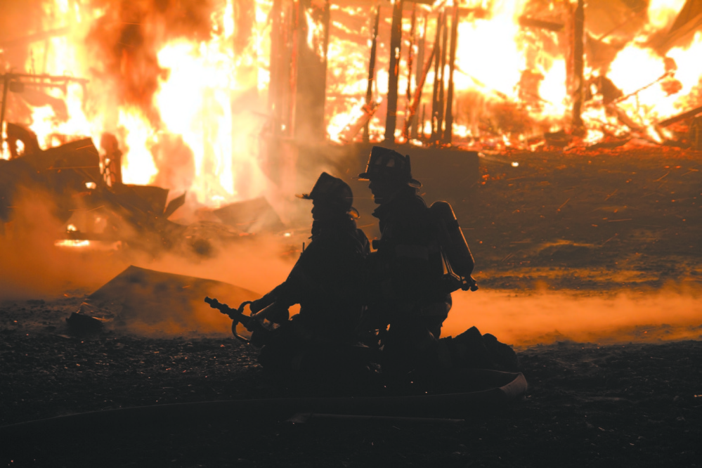 COMMUNITY EFFORT: Flames engulf a barn at Knowlton Corner Farm in Farmington in 2011. Franklin County towns are discussing forming a regional organization to assure towns have fire coverage in the face of declining numbers of volunteers.