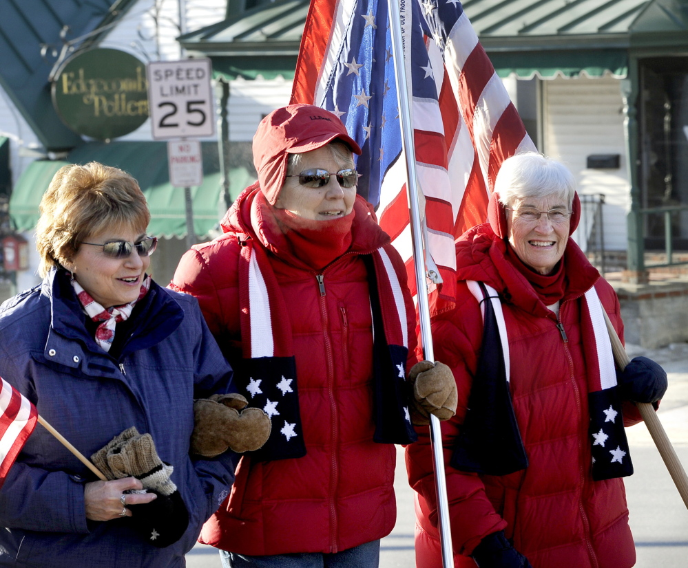 Josephine Holley, left, of South Freeport, was among the dozens of supporters who showed up to support Elaine Greene and JoAnn Miller, two of the original flag ladies, who continued their weekly vigil in downtown Freeport.