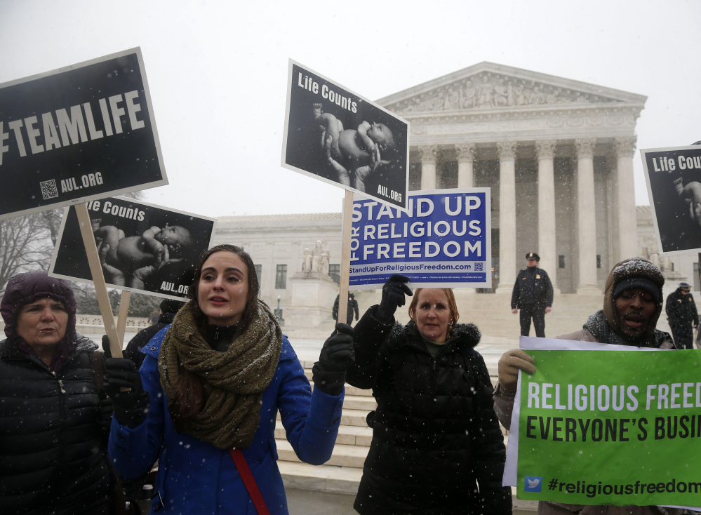 Demonstrators, above and below, rally in front of the Supreme Court in Washington on Tuesday expressing opposite views on the Affordable Care Act requirement that businesses provide female employees with health insurance that includes access to contraceptives.