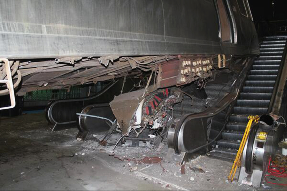 "This photo released Tuesday, March 25, 2014, by the National Transportation Safety Board shows the aftermath of a Chicago commuter train that crashed Monday at O'Hare International Airport when the train jumped off the tracks and climbed an escalator. An NTSB official said Wednesday that the operator of the train admitted she ""dozed off"" before the accident."
