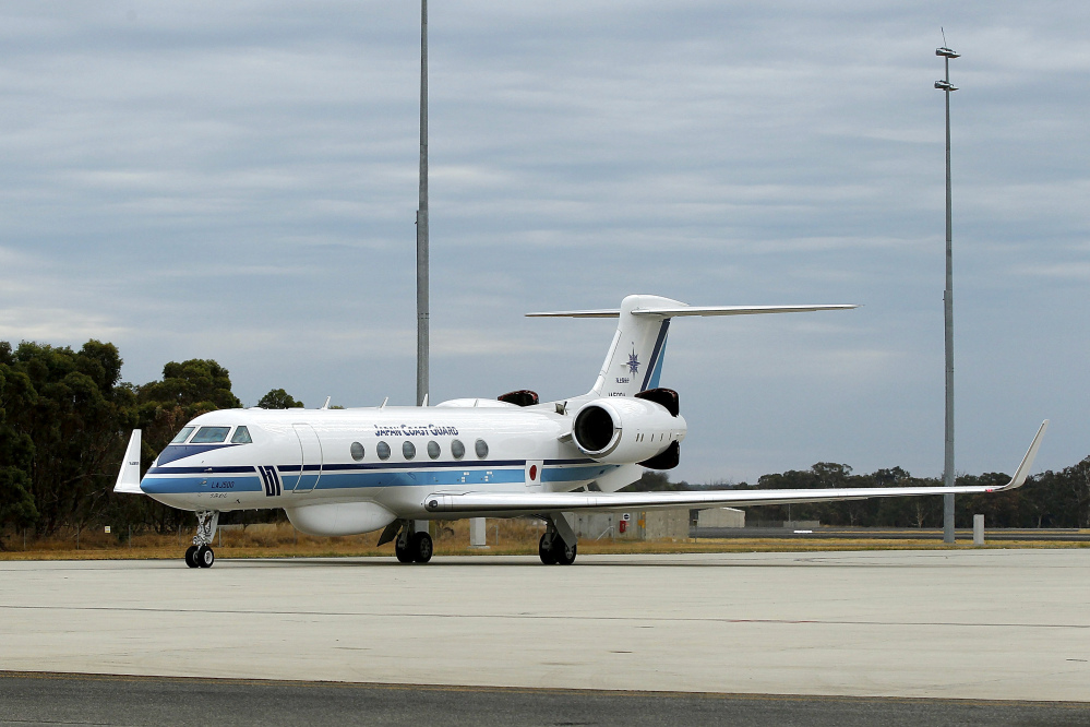 A Gulfstream 5 carrying members of Japan's Coast Guard arrives at Pearce air force base on Wednesday, March 26, 2014, in Bullsbrook, Australia. The desperate, multinational hunt for Flight 370 resumed Wednesday across a remote stretch of the Indian Ocean after fierce winds and high waves that had forced a daylong halt eased considerably. A total of 12 planes and five ships from the United States, China, Japan, South Korea, Australia and New Zealand were participating in the search, hoping to find even a single piece of the Malaysia Airlines jet that could offer tangible evidence of a crash.