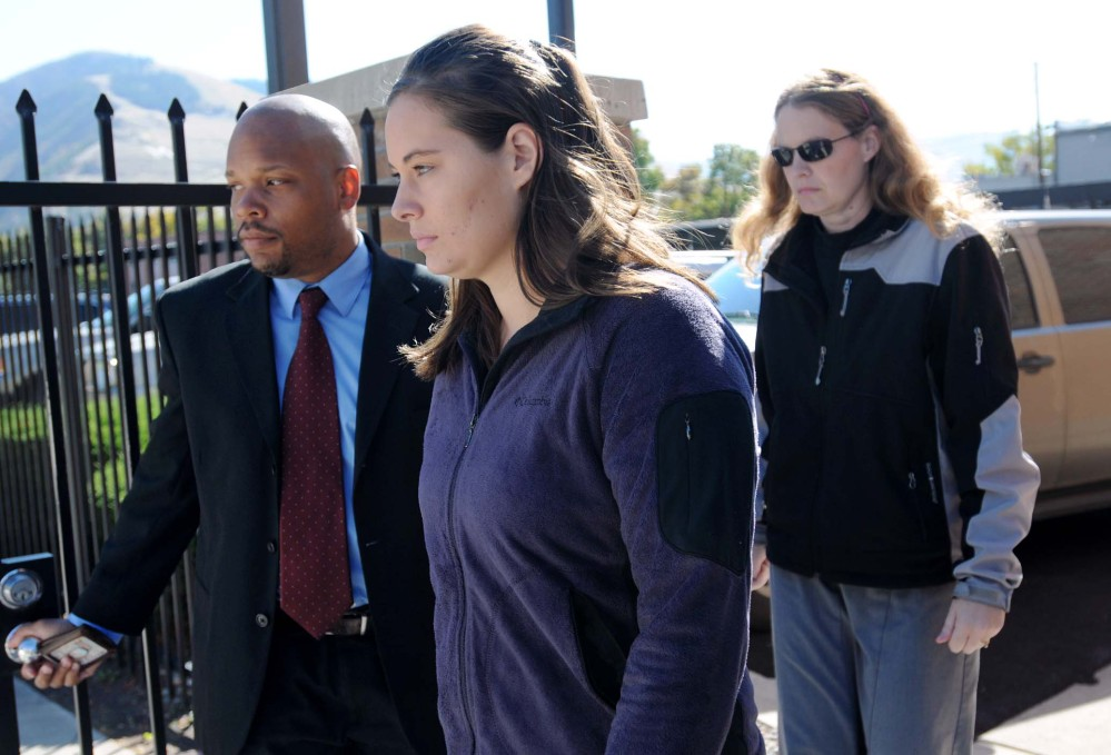 In this October 2013 file photo, Jordan Linn Graham, center, leaves the federal courthouse in Missoula, Mont.