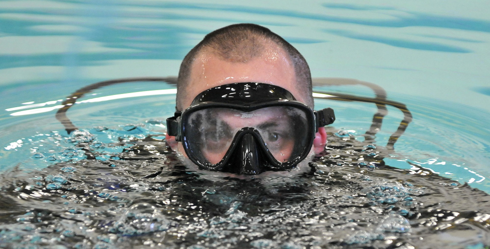 in the water: Josh Hardy, a Kennebec County Sheriff's Office detective, participates in dive training Tuesday.