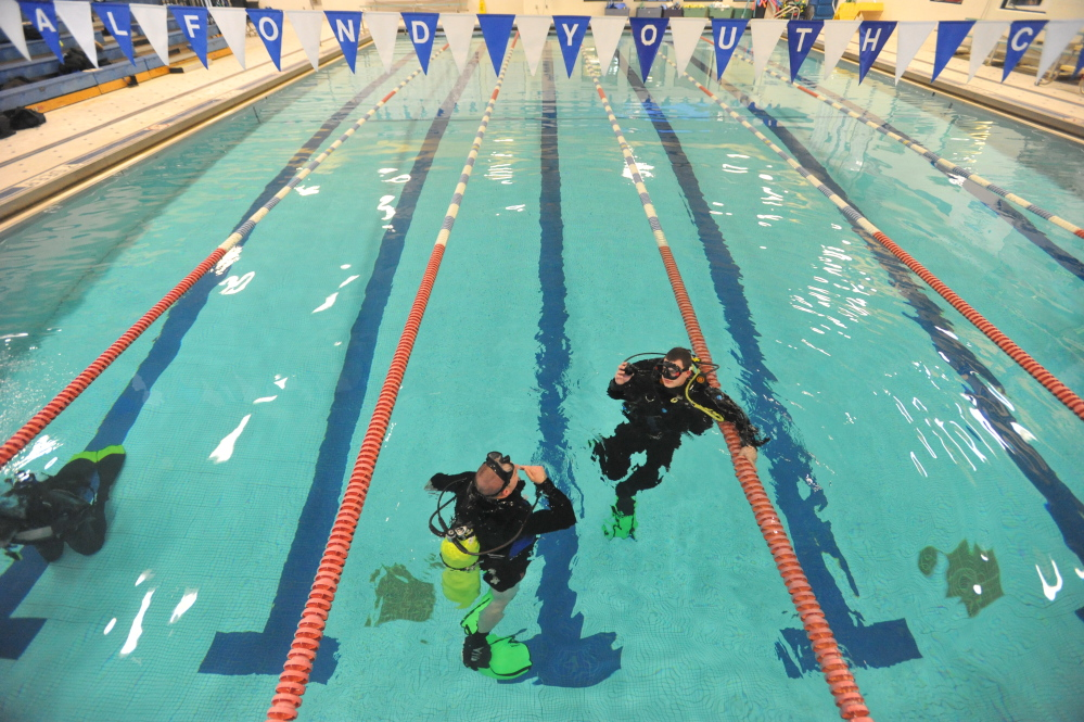 In the Water: Members of the Kennebec County Sheriff's Office dive team train on Tuesday in the pool at the Alfond Youth Center in Waterville..