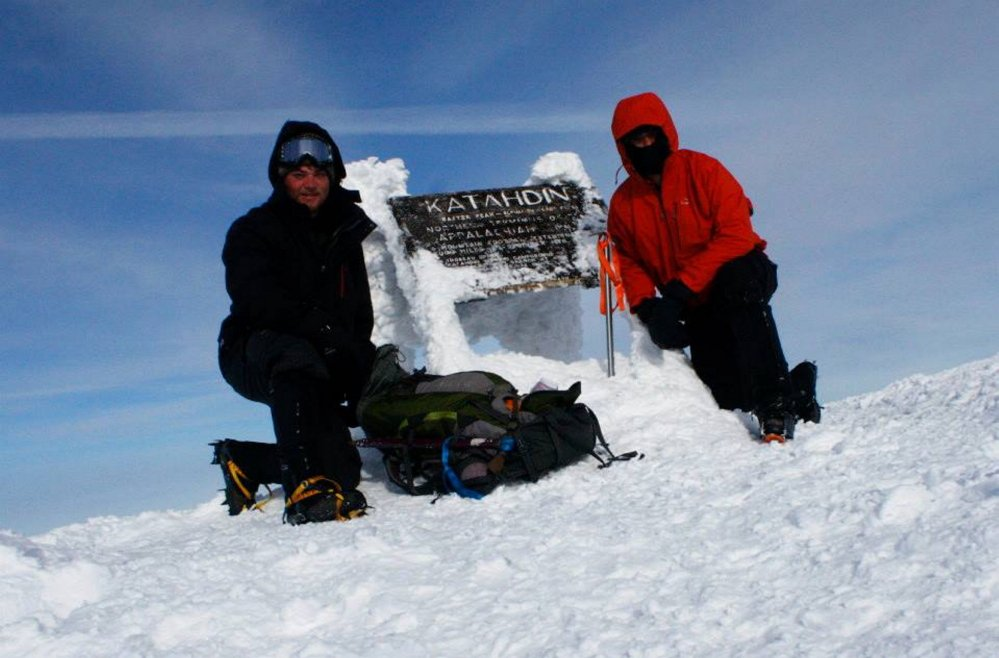 Tyler Heinrich, left, and Willoughby pose by the sign at Baxter Peak, which is the highest point of the Mount Katahdin