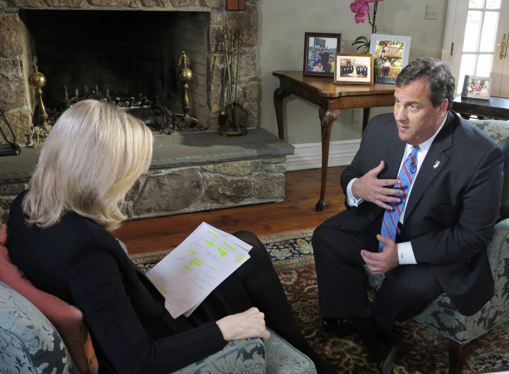 In this photo provided by ABC News, Diane Sawyer speaks to New Jersey Gov. Chris Christie at his home in Mendham, N.J., Thursday.