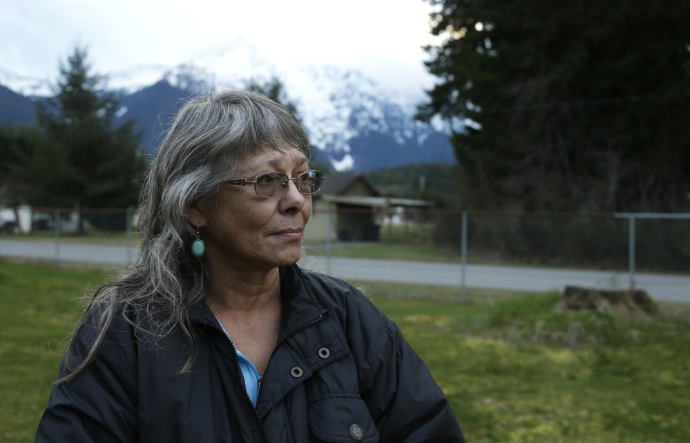 Robin Youngblood survived the massive mudslide that hit the nearby community of Oso, Wash., last Saturday. She was rescued by a helicopter as she floated on a piece of a roof.