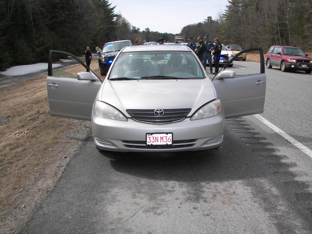 A vehicle is stopped on Interstate 295 Saturday morning. Two people were arrested in connection with a shooting on Cape Cod, Mass.