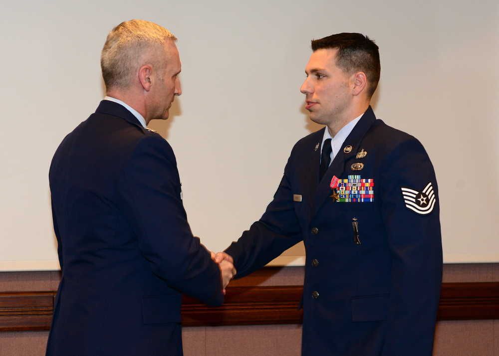High honor: Air Force Tech Sgt. Matt Bolduc, of Oakland, right, shakes hands with Air Force Col. Jeff Hurlbert after Bolduc was awarded the Bronze Star earlier this month.