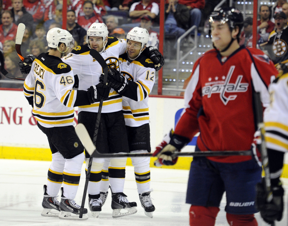Jarome Iginla of the Bruins celebrates his goal against the Capitals with David Krejci, 46, and Andrej Meszaros in the second period Saturday at Washington. The Bruins won, 4-2.