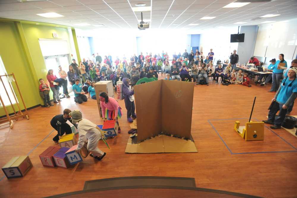 Wood and glue: Students from York Middle School prepare for a Stackable Structure performance Saturday at the state competition of Maine Odyssey of the Mind at Thomas College in Waterville. More than 30 schools from all over Maine competed in the creative problem solving games.