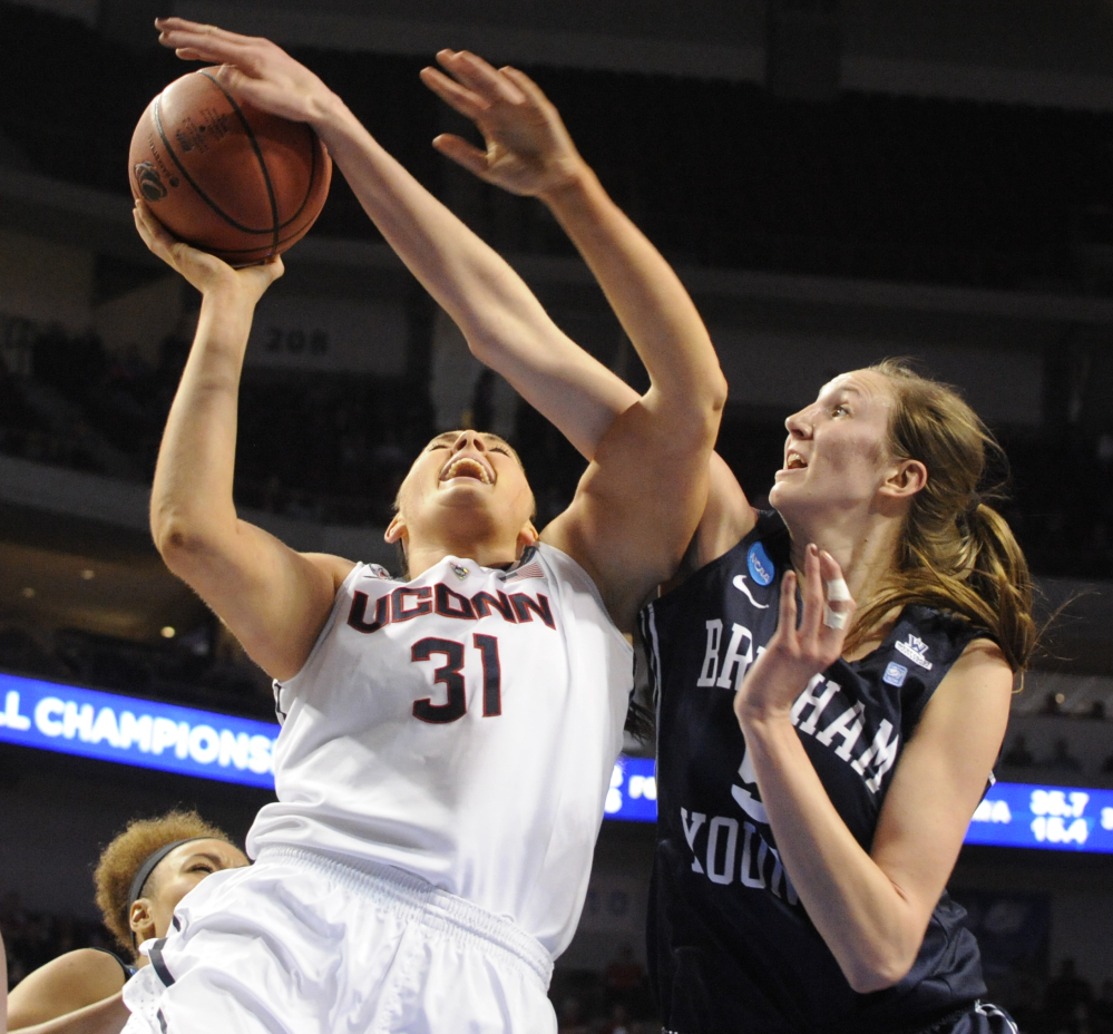 Connecticut's Stefanie Dolson (31) takes a shot in front of BYU's Jennifer Hamson (5) in the NCAA women's basketball tournament Saturday.