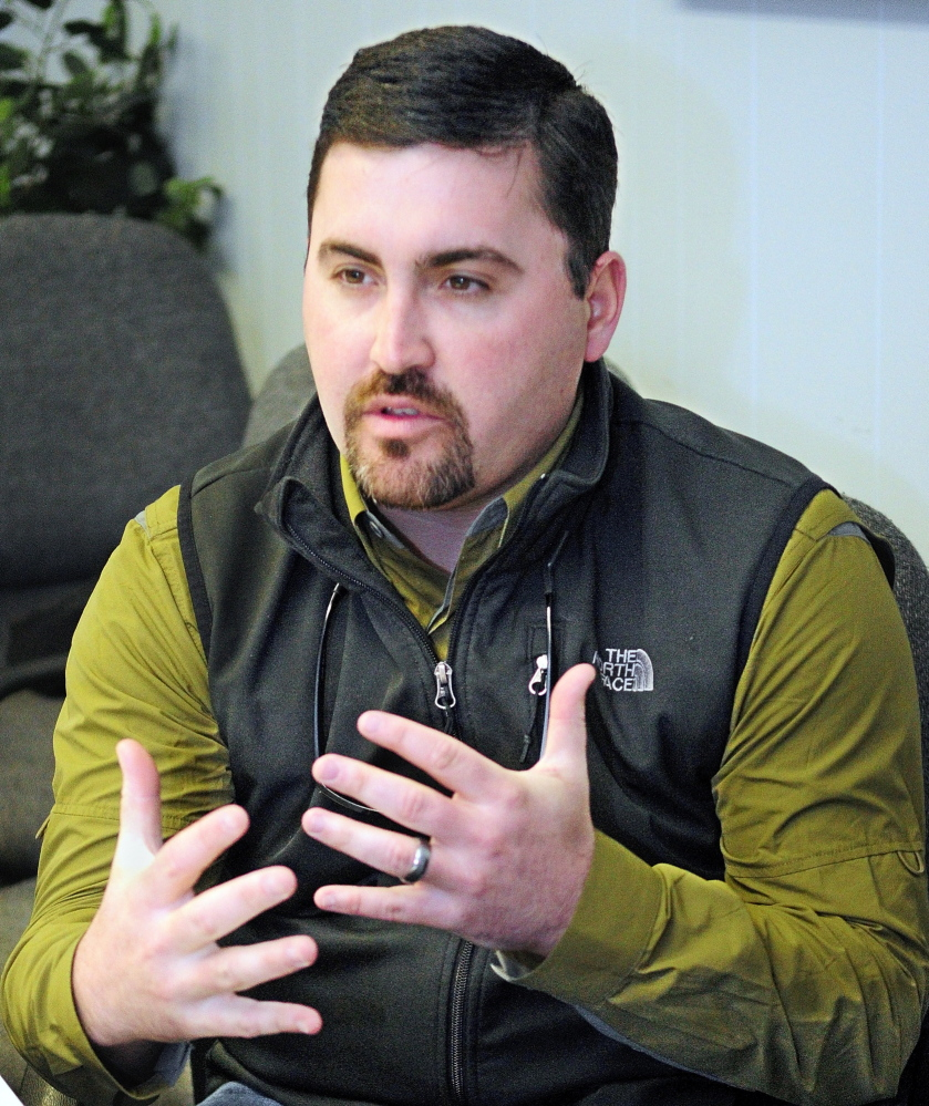 Bear Campaign: James Cote, campaign manager for the Save Maine's Bear Hunt, answers questions Saturday about the bear hunting referendum during an interview at the Maine Sportsman's Show in the Augusta Civic center.