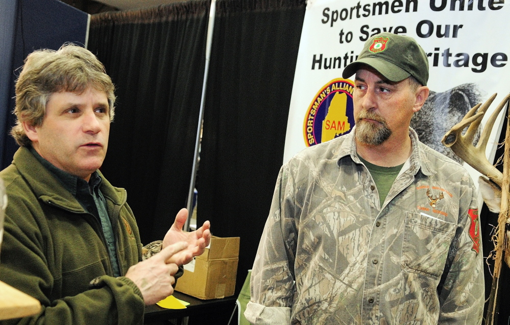 Vanguard of the opposition: David Trahan, executive director of the Sportsman's Alliance of Maine, left, and Matt Whitegiver answer questions about the bear hunt referendum during an interview Saturday at the Maine Sportsman's Show in the Augusta Civic Center.