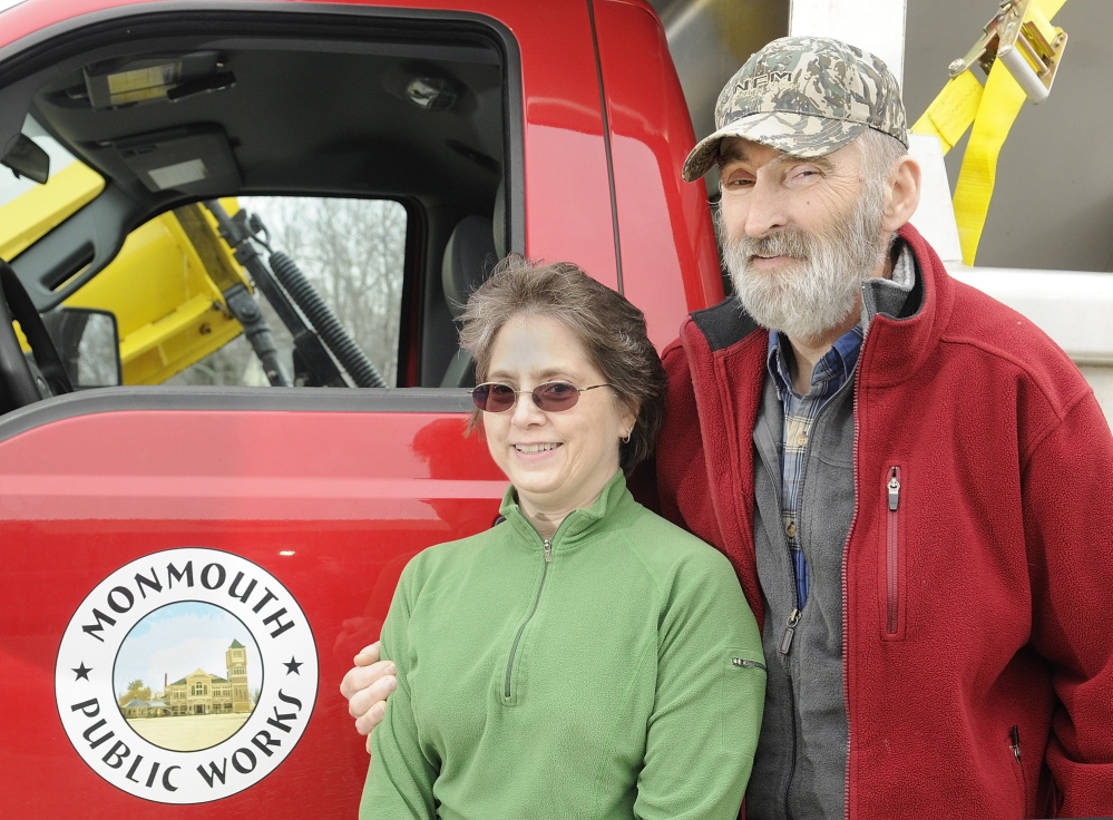 GRATEFUL: Cathy Crocker poses with husband Leonard Crocker beside a Monmouth Public Works truck on Friday at the town garage. Cathy Crocker learned only upon arriving at a Lewiston hospital that her husband had suffered a heart attack, not complications from diabetes.