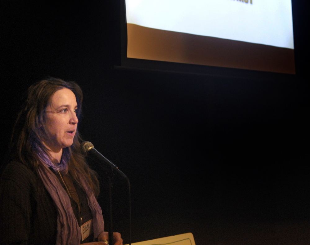 """FOOD MOGUL: Sarah Miller introduces the documentary film """"Fresh"""" on Sunday at Johnson Hall Performing Arts Center in Gardiner. Miller's group, the Gardiner Food Co-Op and Cafe, sponsored the event."""