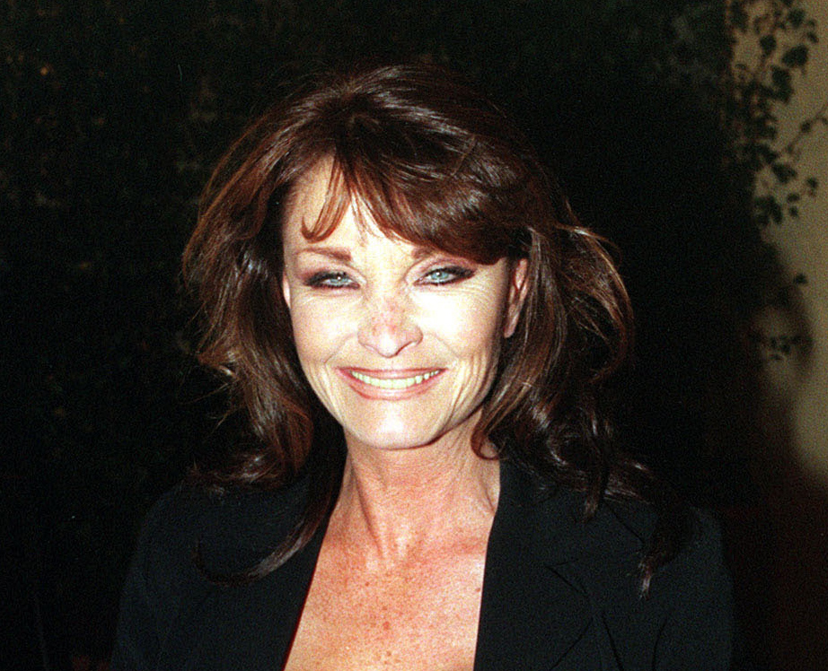 """British actress Kate O'Mara poses for photographers in this October 1998 photo O'Mara, best known for her role in the 1980s soap opera """"Dynasty,"""" died at the age of 74 in a nursing home in southern England after a short illness."""