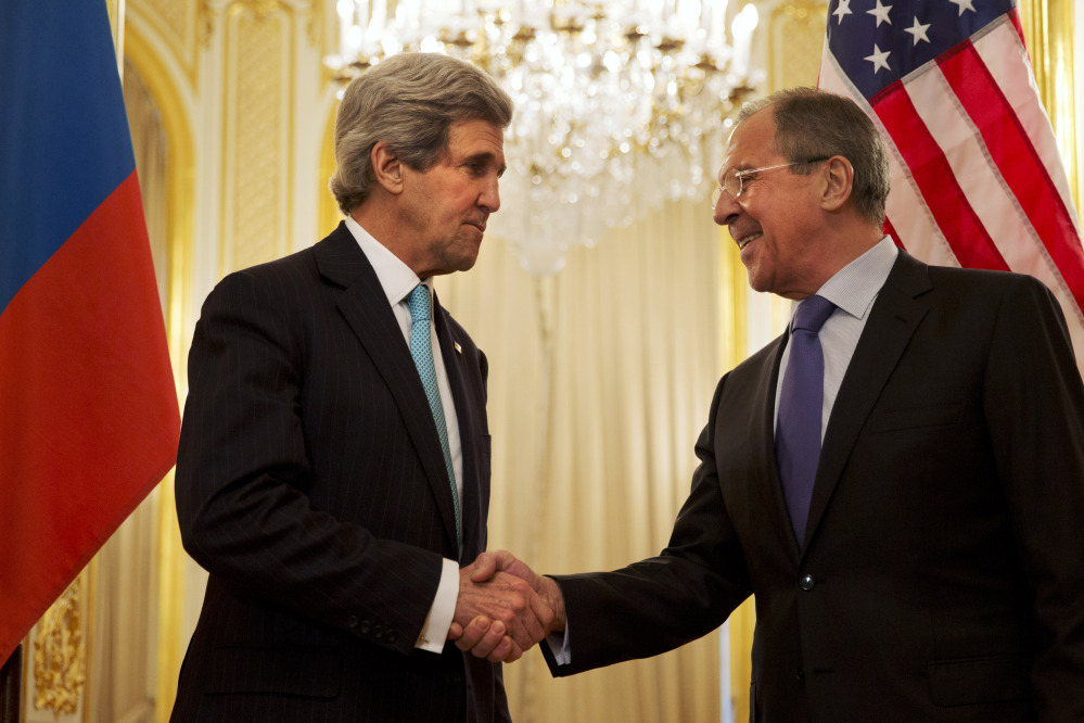 Secretary of State John Kerry, left, greets Russian Foreign Minister Sergey Lavrov before the start of their meeting about the situation in Ukraine in Paris on Sunday.