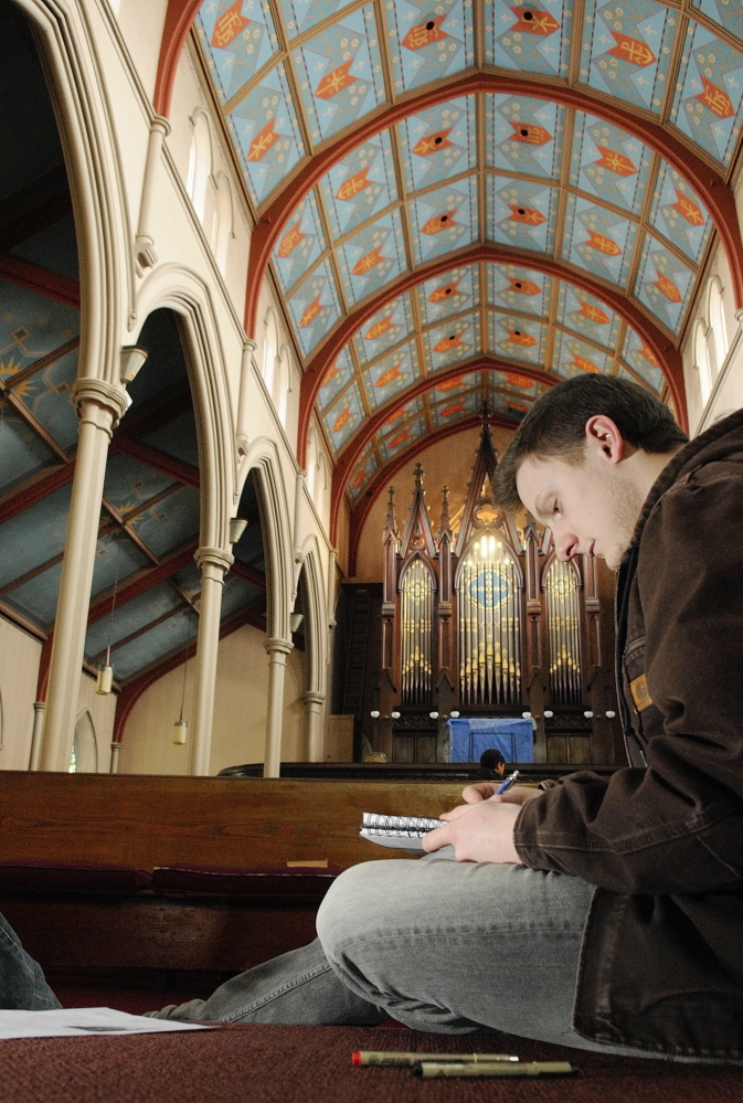 Ben Bailey, of Farmington, draws the walls inside South Parish Congregational Church on Thursday in Augusta.