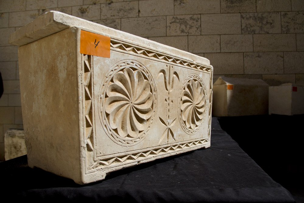 A 2,000 year-old Jewish burial box is on display in Jerusalem on Monday. The Israeli Antiquities Authority said the boxes were recovered Friday in Jerusalem when police observed a suspicious nighttime transaction.