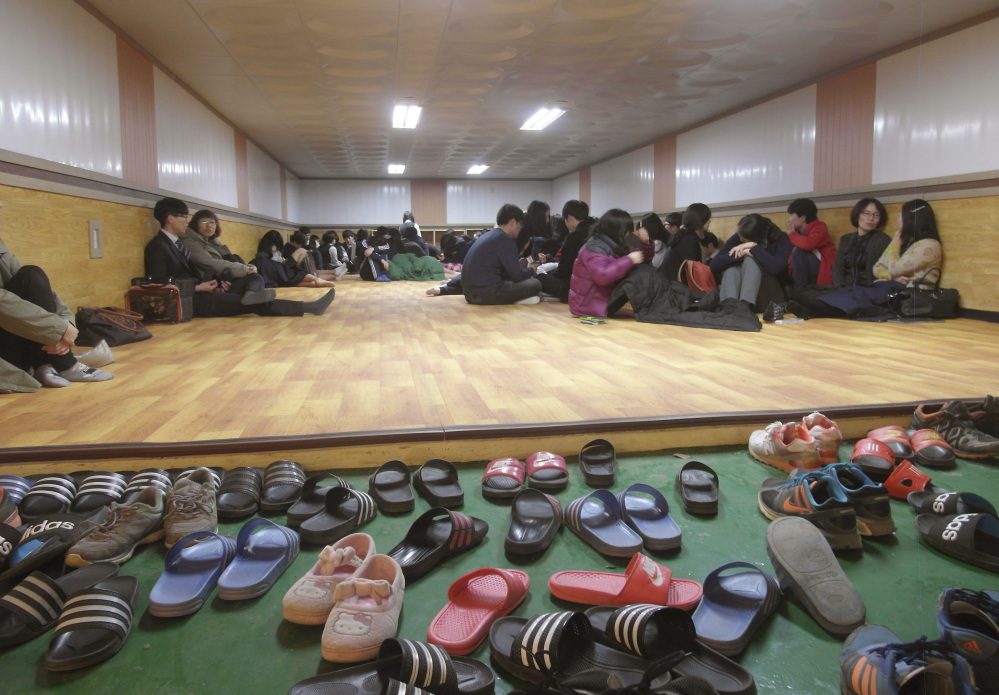 Residents and students of Yeonpyeong Island, South Korea, evacuate to a shelter on the island near the West Sea border with North Korea on Monday.