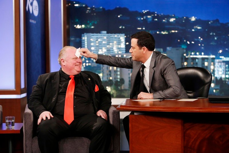 """This March 3, 2014 image released by ABC shows Toronto Mayor Rob Ford, left, having his forehead wiped by host Jimmy Kimmel on the late night talk show """"Jimmy Kimmel Live,"""" in Los Angeles. Ford laughed off Jimmy Kimmel's suggestion that he get help for his drinking problem and was reported to be upset about his appearance on the late-night TV talk show. Ford's appearance Monday night on """"Jimmy Kimmel Live"""" in Los Angeles was the culmination of months of wooing by the talk-show host to get Ford to appear as a guest."""