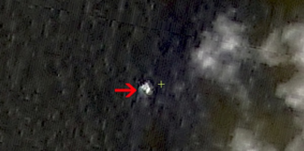 In this March 9, 2014 satellite image seen on the website of the Chinese State Administration of Science, Technology and Industry for National Defense, floating objects are seen at sea next to the red arrow which was added by the source. China's Xinhua News Agency reported Wednesday that the images show suspected debris from the missing Malaysia Airlines jetliner floating off the southern tip of Vietnam.