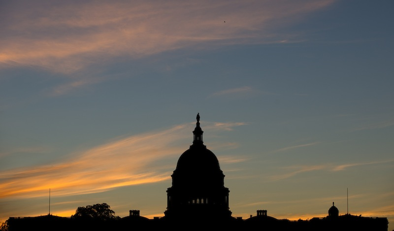 In this September 2013 file photo, the U.S. Capitol dome is silhouetted by the sunrise. Doctors who treat Medicare patients would get a last-minute reprieve from a scheduled 24 percent cut in their reimbursements from the government under a bill that's on track to pass the House. It would be the 17th time Congress has stepped in with a temporary fix to a poorly designed Medicare fee formula that dates to a 1997 budget law. House action comes after efforts to permanently fix the formula appear to have fizzled.