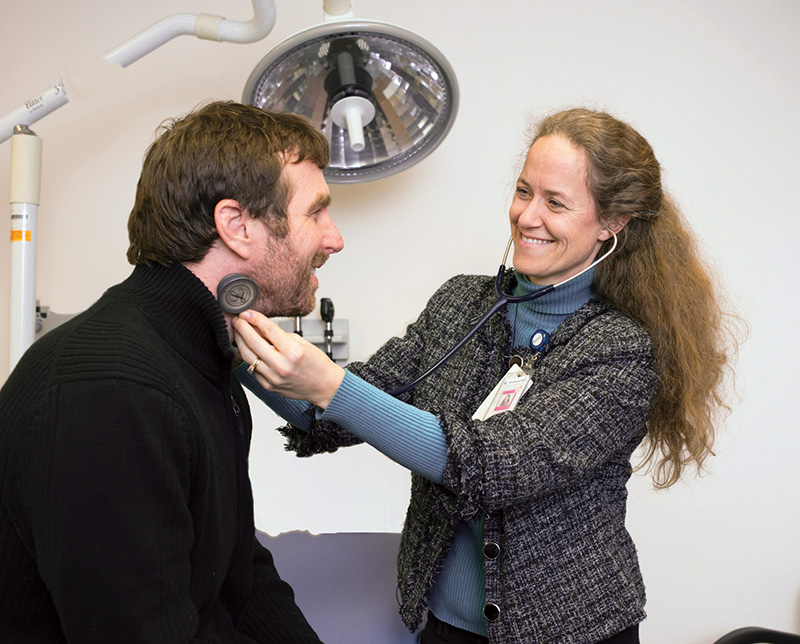 Dr. Stephanie Calkins examines a patient at Four Seasons Family Practice in Fairfield.
