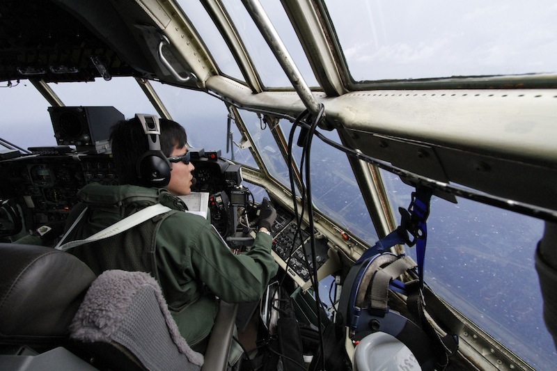 Japanese Air Self-Defense Force copilot Ryutaro Hamahira scans the ocean aboard a C-130 aircraft while it flies over the search area in the southeastern Indian Ocean on Friday.
