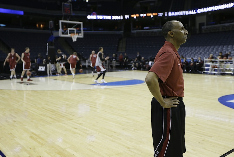 Stanford head coach Johnny Dawkins watches during practice at the NCAA college basketball tournament, Wednesday, March 26, 2014, in Memphis, Tenn. Stanford plays Dayton in a regional semifinal on Thursday. FEDEX FORUM March Madness