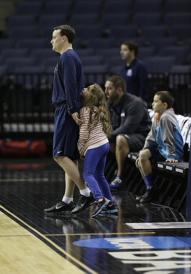 Dayton head coach Archie Miller watches practice with his daughter Leah Grace during practice at the NCAA college basketball tournament, Wednesday, March 26, 2014, in Memphis, Tenn. Dayton plays Stanford in a regional semifinal on Thursday. March Madness