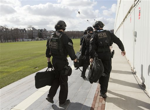 Members of the Secret Service Counter Assault Team, known in the agency as CAT, are seen before boarding helicopters in Amsterdam Monday.