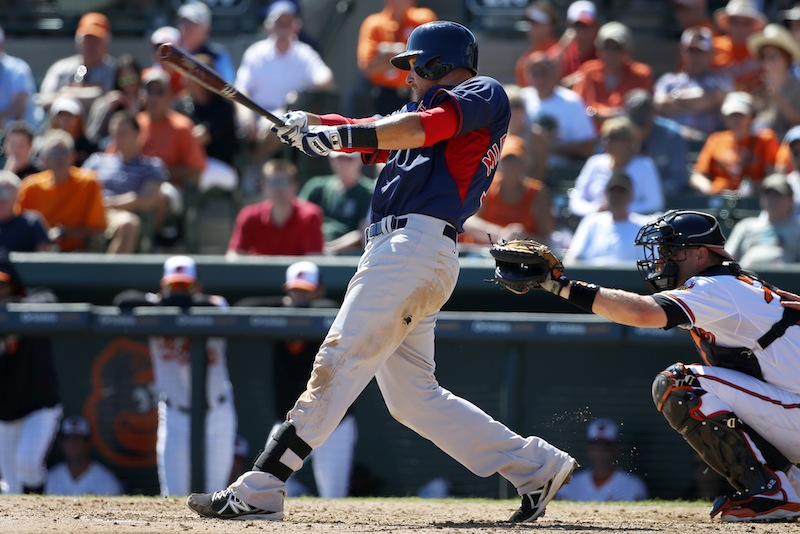 Boston Red Sox's Will Middlebrooks hits a solo-home run off Baltimore Orioles relief pitcher Tommy Hunter during the fourth inning of an exhibition spring training baseball game in Sarasota, Fla., on Saturday.