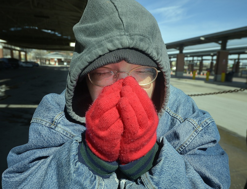 Dana Maxwell tries to keep warm at Intermodal Transportation Center in Fort Worth, Texas, Monday, March 3, 2014. The couple said that they are homeless and had to leave the Presbyterian Night Shelter at 7 a.m. and plan to ride the bus all day to keep warm. The National Weather Service issued a wind chill advisory until midmorning Monday for the Dallas-Fort Worth area. Forecasters say sunny conditions should return by Tuesday with highs in the upper 40s.