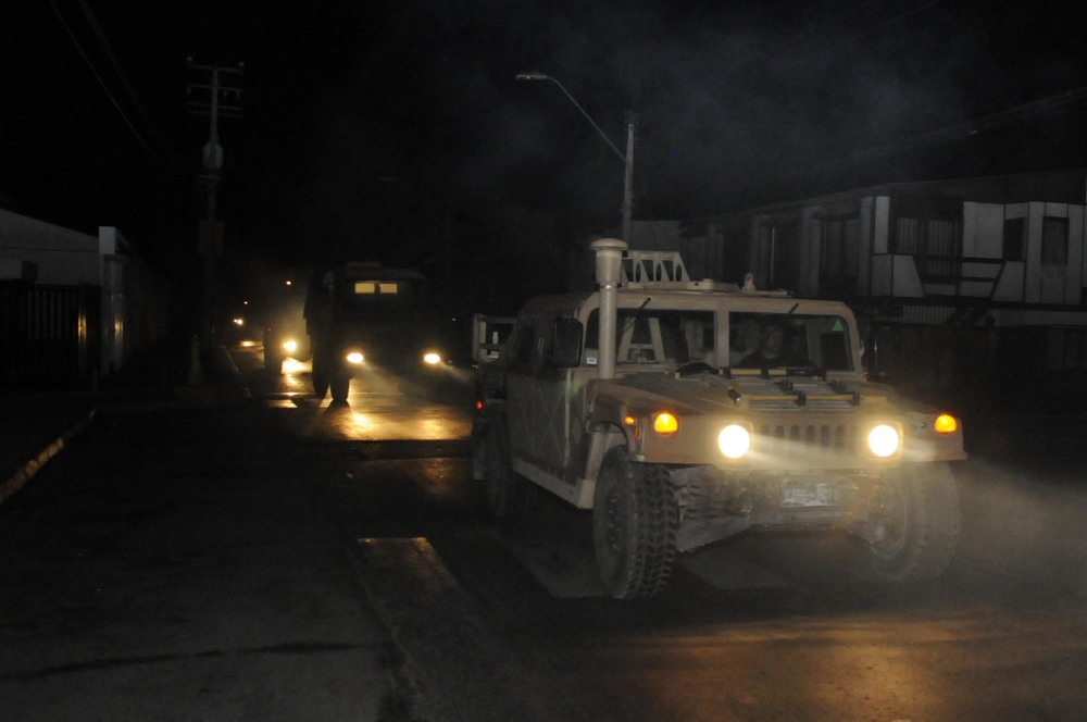 A military vehicle patrols in Iquique, Chile, after an earthquake in Tuesday set off a small tsunami that forced evacuations along the country's entire coast.