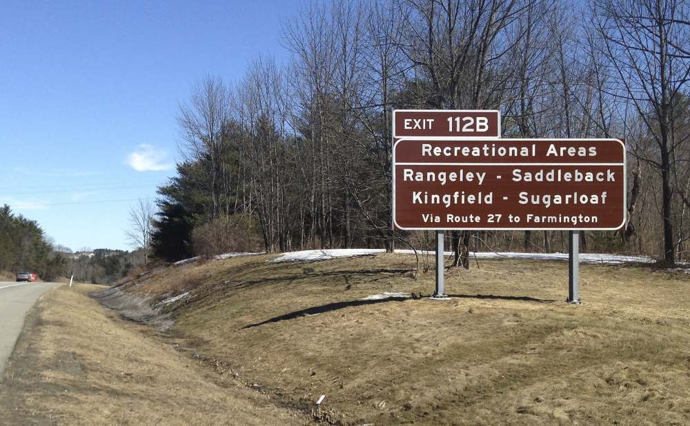 A sign for exit 112B on the Maine Turnpike near Augusta informs motorists of the exit to take for the Sugarloaf and Saddleback ski areas.