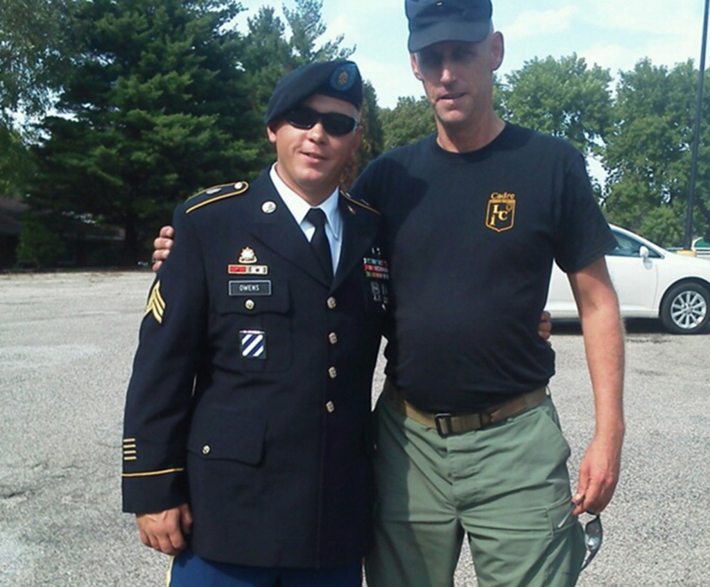 This undated family photo shows U.S. Army Sgt. Tim Owens, left, of Effingham, Ill., with his cousin Glen Welton. Owens was one of three people killed by a shooter at Fort Hood, Texas on Wednesday, April 2, 2014.
