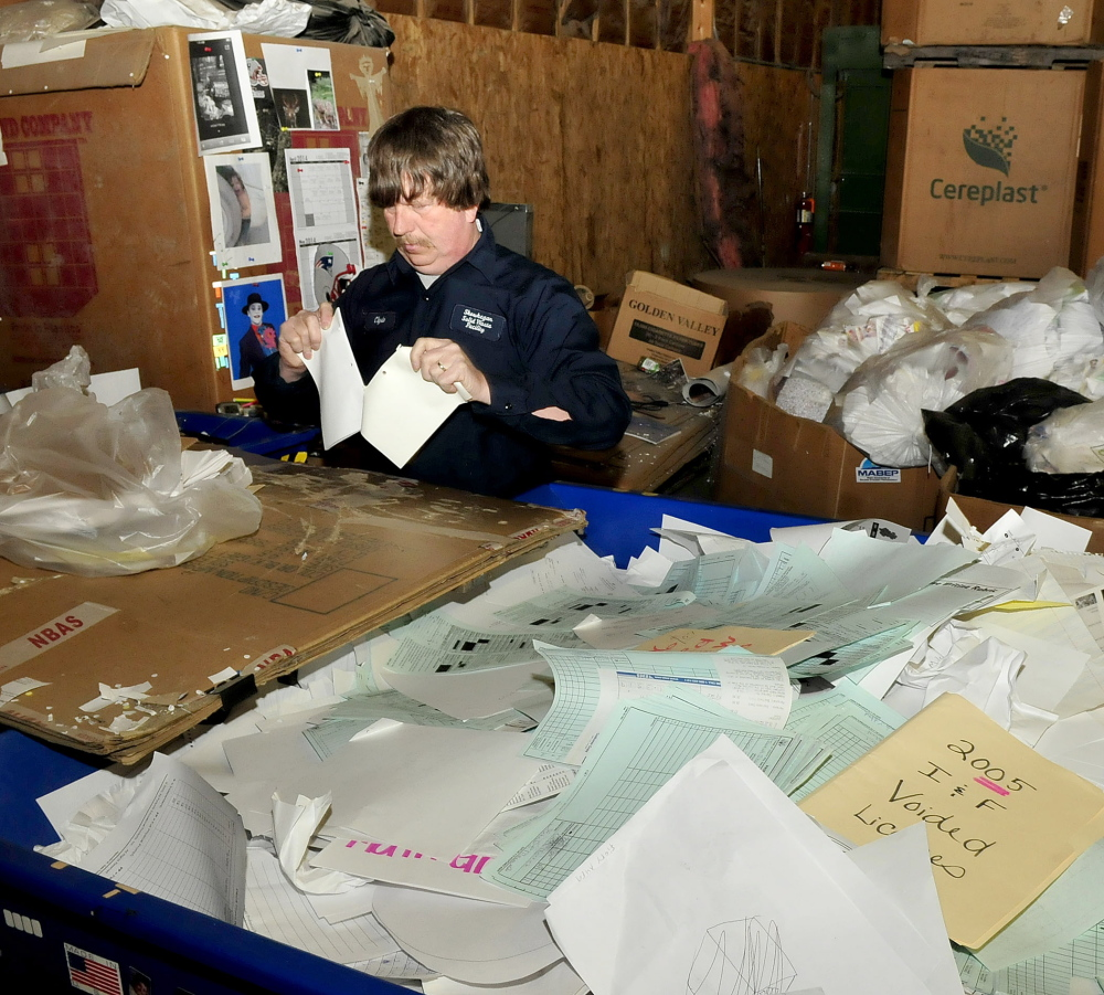 MORE BIZ: Skowhegan Recycling Center employee Clyde Merrill sorts high grade office paper at the center on Thursday. The center will soon receive more materials from the town of Cornville.
