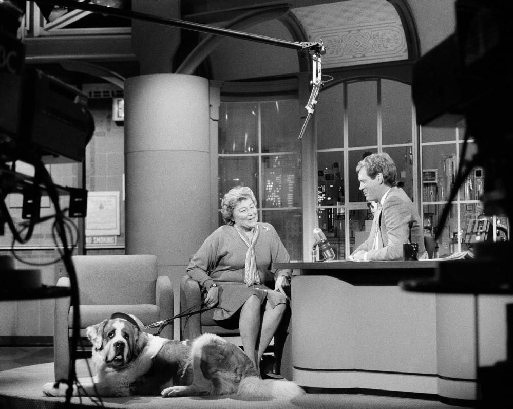 "Marge Schott, owner of the Cincinatti Reds, and her dog Schotzy appear on ""Late Night With David Letterman,"" during a taping of the show, May 13, 1986."