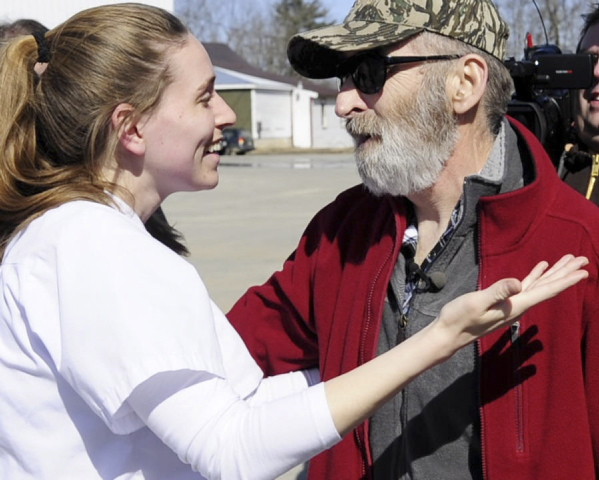 ANGEL IN SCRUBS: Hayley Rolfe hugs Leonard Crocker on Friday at Monmouth Public Works. Rolfe, a nursing student, stopped to help several weeks ago when Crocker was having a heart attack.