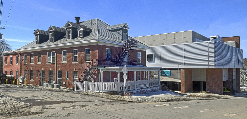 NEW OCCUPANTS: The Haynes Building at the corner of St. Catherine and East Chestnut Streets, left, just up hill from the former MaineGeneral Medical Center is seen in this photo taken on Friday in Augusta. The Muskie Center of Public Policy will move there from the Central Maine Commerce Center in north Augusta.