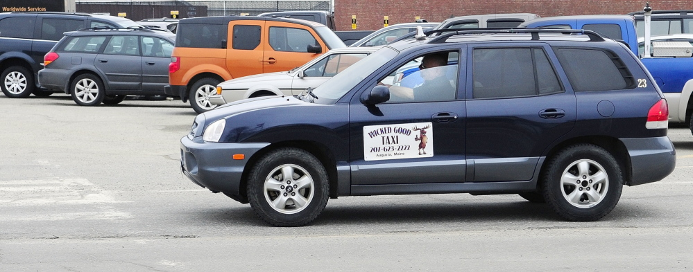 Risky job: Paul Marquis drives a cab for his business, Wicked Good Taxi, on Wednesday in Augusta.