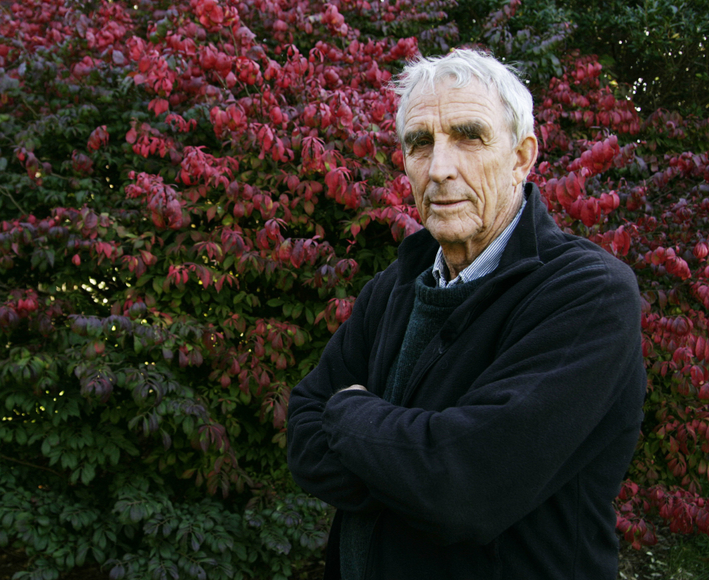 Peter Matthiessen stands in his yard in Sagaponack, N.Y., in 2004.